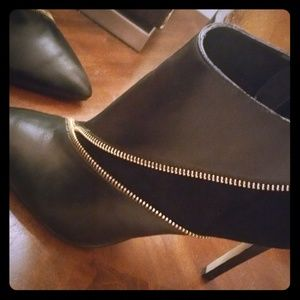 Schultz brand ankle heeled boots with gold zipper